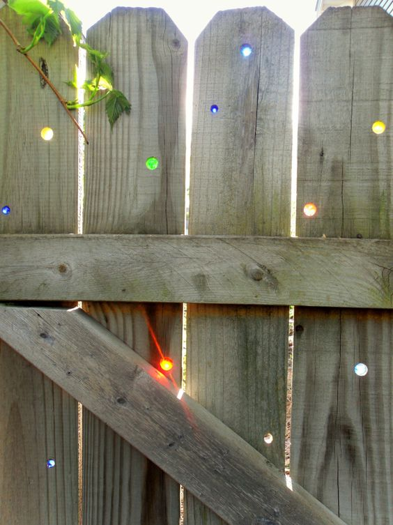 Glass Marbles on Fence